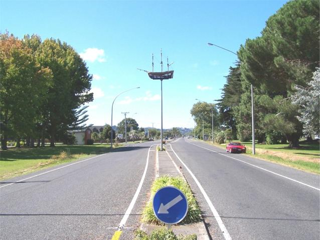 Gladstone Road at the entrance to Gisborne showing model ship