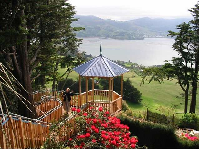 Larnach Castle grounds with a view from the ridge of Otago Peninsula of the water