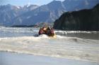 Tourists Approaching Ice on the Tasman Glacier Lake