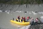 Tourists Landing at the Tasman Glacier
